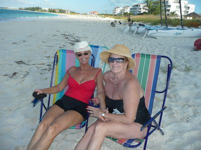 Visiting with friends while enjoying the soft breezes on Grace Bay Beach