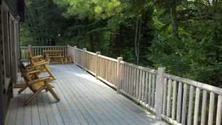 Grayling lodge photo - Wrap-around deck overlooking Au Sable