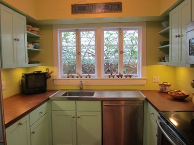 The cheery kitchen boasts up-to-date appliances and dade county pine counters.