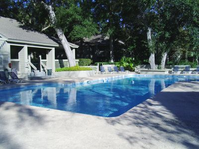 Private pool has sun deck, lounge chairs and book swap area.