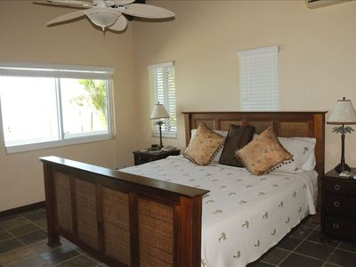 King bedroom master suite in the main house with Ocean view and doors to pool