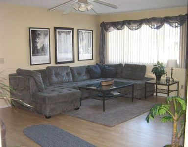 Livingroom with comfy sectional, recliner and large screen tv & satellite