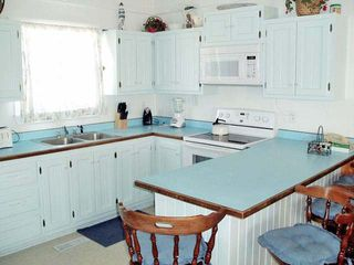 Corolla house photo - This kitchen comes with Gallery Seating!