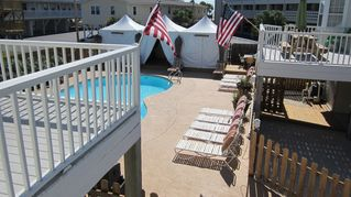 Gulf Shores bungalow photo - Pool area with Cabanas with view of bridges that connect all Bungalows,no sand!!