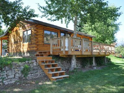 View of riverfront-side of the cabin. Huge deck for enjoying the scenery.