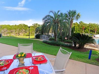 Enjoy a meal out on the patio on a perfect sunny afternoon! steps to the pool