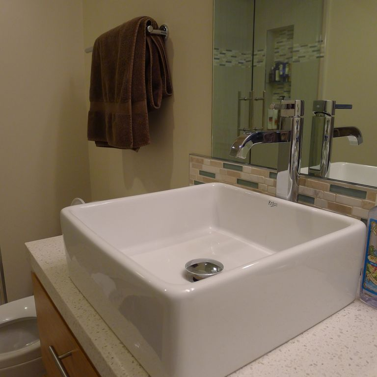 Modernized bathrooms with mounted sinks