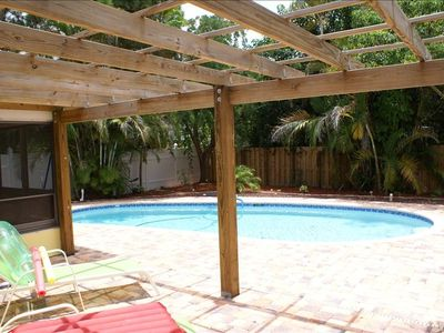 South facing tropical Patio area. Grill and privacy fence for seclusion.
