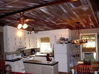 Upstairs Antique Tin Ceilings make the chalet feel rustic & cozy.