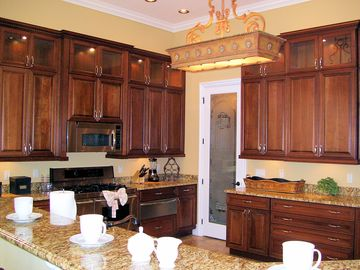 Huge Kitchen with large breakfast bar overlooking the living room and pool