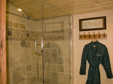 Upstairs, master bath with double headed travertine shower