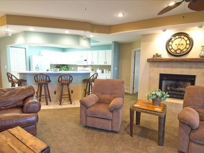 Double size living room/kitchen with plush high end furnishings/cozy fireplace.
