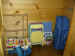 Sevierville cabin photo - toys, table/chairs, crib, gates in bedroom closet