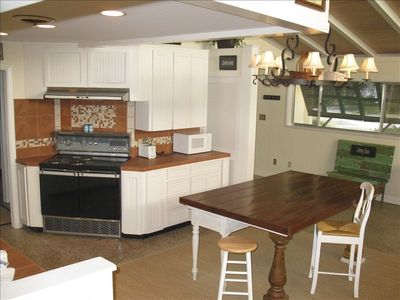 The kitchen is a fun area for the chef and guests to gather!