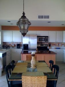 Kitchen / dining with granite island, stainless steel appliances; ocean view