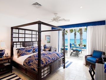Master Bedroom Suite with Bath looks to Terrace and Beach