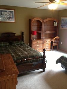 One of 5 bedrooms, two queens in two of the bedrooms . very spacious rooms.