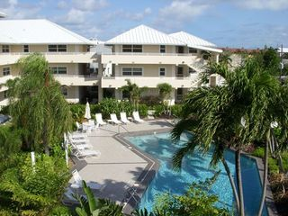 Grand Cayman condo photo - Cayman Club pool & hot tub- gorgeous landscape