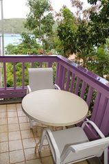 Cruz Bay condo photo - You will enjoy the harbor views from the bedroom balcony.