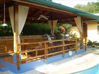 The spacious covered rancho is a shady gathering place beside the pool.