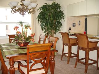 Fort Myers Beach condo photo - Elegan dining area and breakfast bar.