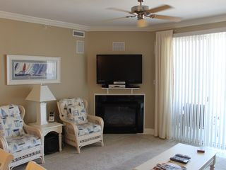 Belmont Towers Ocean City condo photo - Left side of Living Room View with in wall speakers large HD TV Bluray DVD