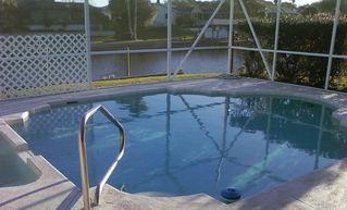 Palm Coast house photo - Salt Water Canal, backyard pool and jacuzzi, right out your sliding glass doors