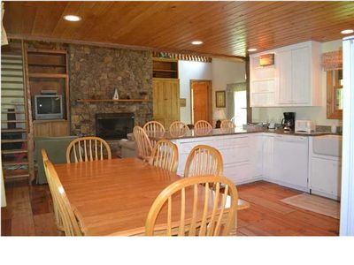 New photos - Rock Creek Cabin Kitchen and living area with large fireplace.