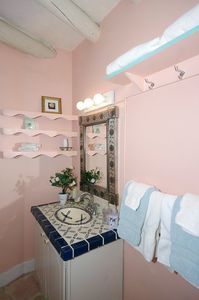Mexican tile sink and hammered tin mirror; ceiling vigas. Hairdryer provided.