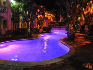 Aruba condo photo - POOL AREA AT NIGHT WITH LED LIGHTS THAT CHANGE COLOURS