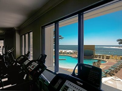 Full workout facility overlooking pool and harbor