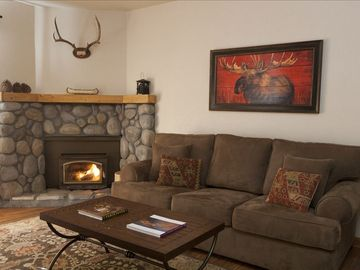 Mammoth Lakes condo rental - Open layout, wood-burning fireplace, sleeper sofa (full), partial mountain views
