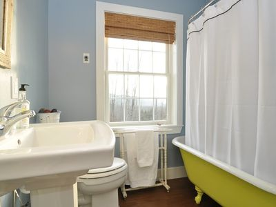 The guest bath has an antique claw foot soaking tub that is also a shower.