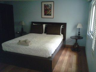 Master bedroom with 3 windows overlooking interior patios - San Juan apartment vacation rental photo