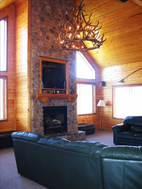 Family Room has a large U shaped couch, gas fireplace, & TV w/ Satellite, & DVD