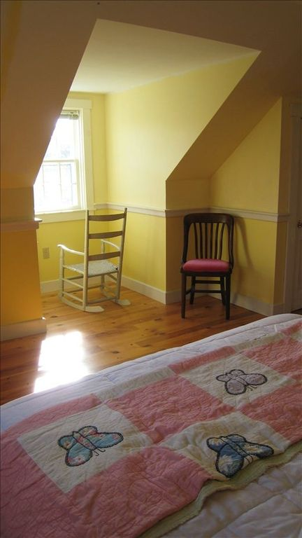 The yellow bedroom upstairs -- a queen bed and fabulous dormer window ocean view