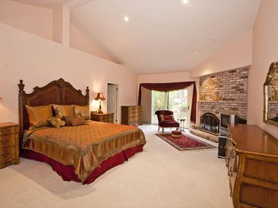 Master Suite with King Size bed, fireplace and jacuzzi tub.