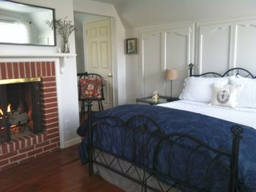 Los Olivos cottage rental - Enjoy the upstairs fireplace from the comforts of bed in the master suite