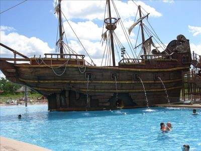 Enjoy the famous pirate ship pool with slide!