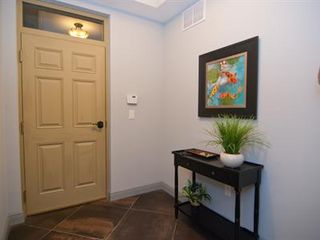 Cocoa Beach condo photo - Enter the foyer w/transom window, coat & umbrella rack & alarm system.