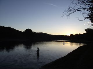 Branson condo photo - At dusk fisherman hoping to catch the elusive big brown trout.