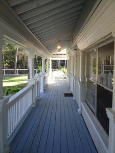 55 ft. front porch with casual southern white whicker seating at each end