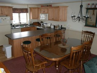 North Conway condo photo - Fully furnished kitchen and dining area. Mud room w/large closet off kitchen.