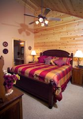 Master bedrooms are very spacious, tv in every bedroom as well as a private bath - Branson cabin vacation rental photo