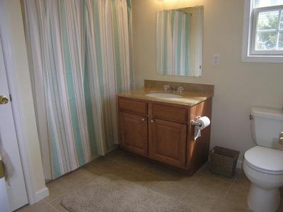 Roomy master bath with granite counter top, features a shower with tub.