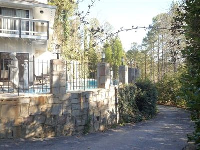 Contemporary home nestled into large, wooded lot with private drive