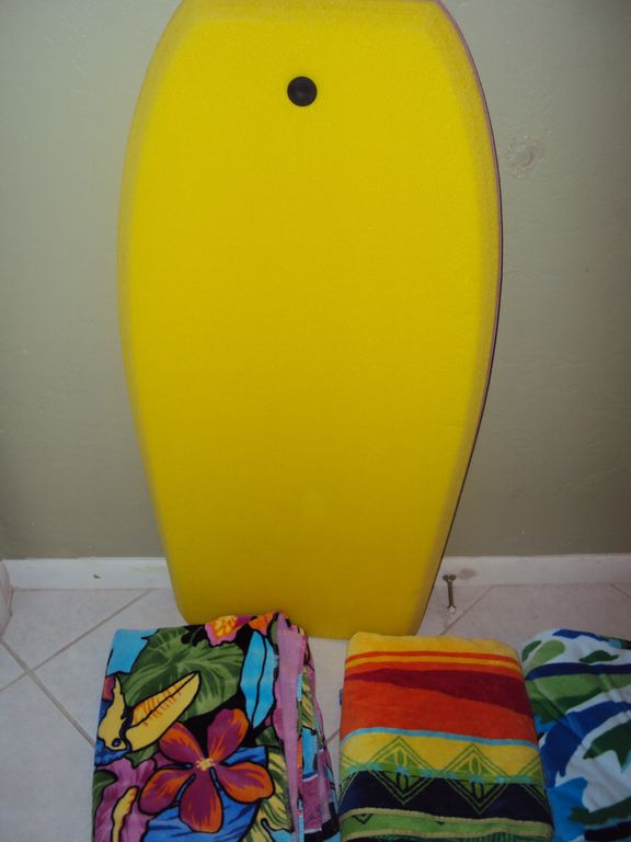 Surf Board and Beach towels