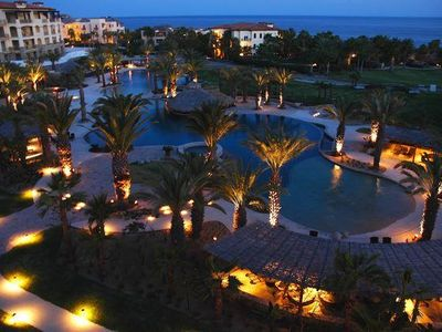 Lavish resort pools at twilight