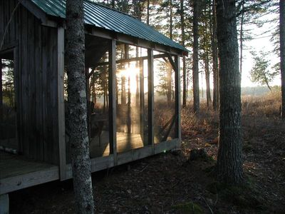 Screened gazebo at sunset