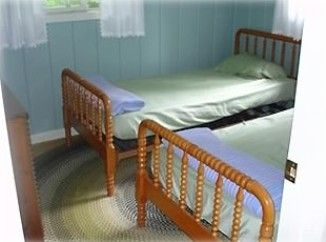 Two twin Jenny Lynn style bed's.